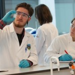 Science Outreach, O'Brien Centre for Science - students in lab coats in Chemistry laboratories