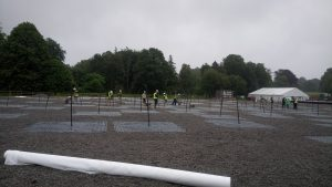 All of us hard at work laying down the geotextile and gravel on the LBA field""