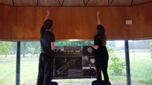 Rachel and myself putting up a poster for the exhibition in the pavilion