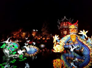The Chinese gardens in Montreal lit up by lights at night.